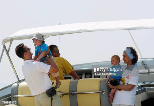 Spanish Royal family on holiday in Palma Queen Sofia with her two grandsons Pablo Nicolas and Juan Valentin and her soninlaw Inaki Urdangarin