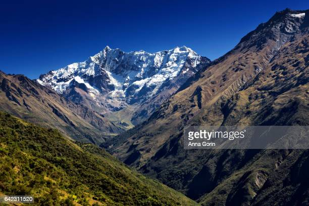 Day One route of multi-day Salkantay Trek to Machu Picchu, autumn afternoon in Peru with snowcapped mountain range looming in distance