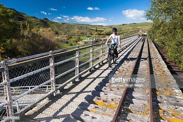 a day riding bikes through the otago rail trail. - otago region stock pictures, royalty-free photos & images
