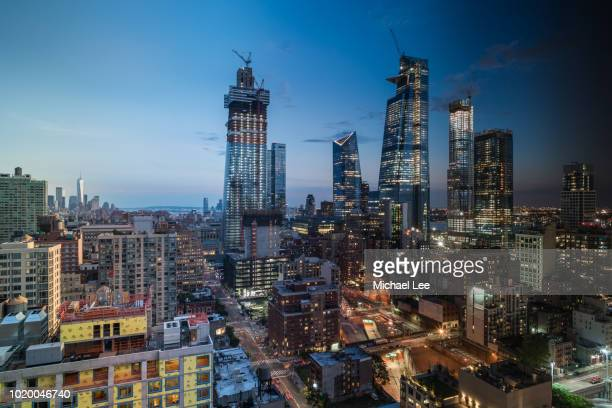 day to night construction scene - new york - hudson river stock pictures, royalty-free photos & images