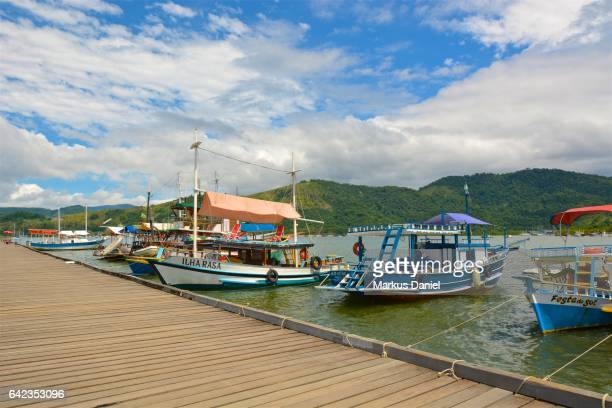Day trip boats at the main pier in the town of Paraty, Rio de Janeiro