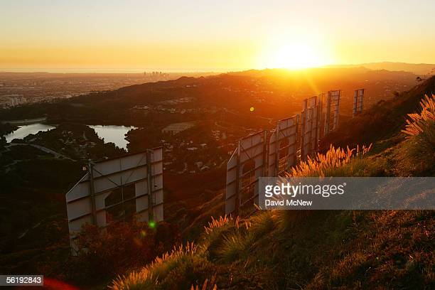 Day turns to night at the Hollywood Sign on November 16 2005 in Los Angeles California The historic landmark is undergoing a monthlong makeover...