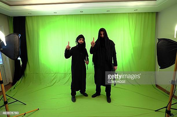 Daya Al Taseh members Main and Mohammad perform a sketch in a secret home studio on January 242015 in Gaziantep south east Turkey a city near syrian...