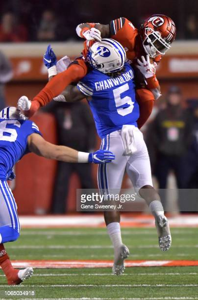 Dayan Ghanwoloku of the Brigham Young Cougars tackles the leaping TJ Green of the Utah Utes in the second half of a game at RiceEccles Stadium on...