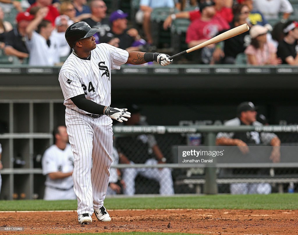 Dayan Viciedo #24 of the Chicago White Sox follows the flight of his two-run home run in the 5th inning against the Minnesota Twins at U.S. Cellular Field on August 3, 2014 in Chicago, Illinois.
