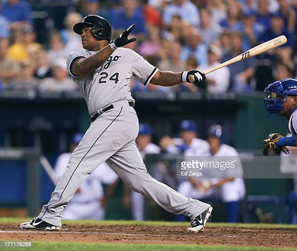 Dayan Viciedo of the Chicago White Sox hits a grand slam in the fourth inning against the Kansas City Royals at Kauffman Stadium August 21 2013 in...