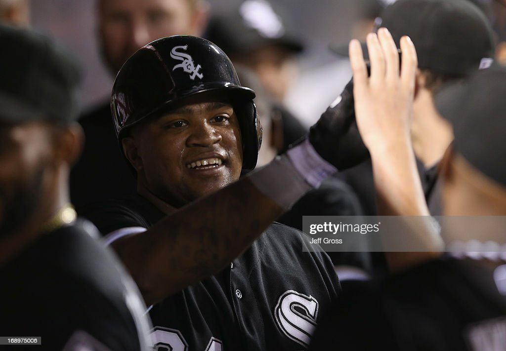 Dayan Viciedo #24 of the Chicago White Sox receives high fives in the dugout after scoring a run against the Los Angeles Angels of Anaheim in the seventh inning at Angel Stadium of Anaheim on May 17, 2013 in Anaheim, California.