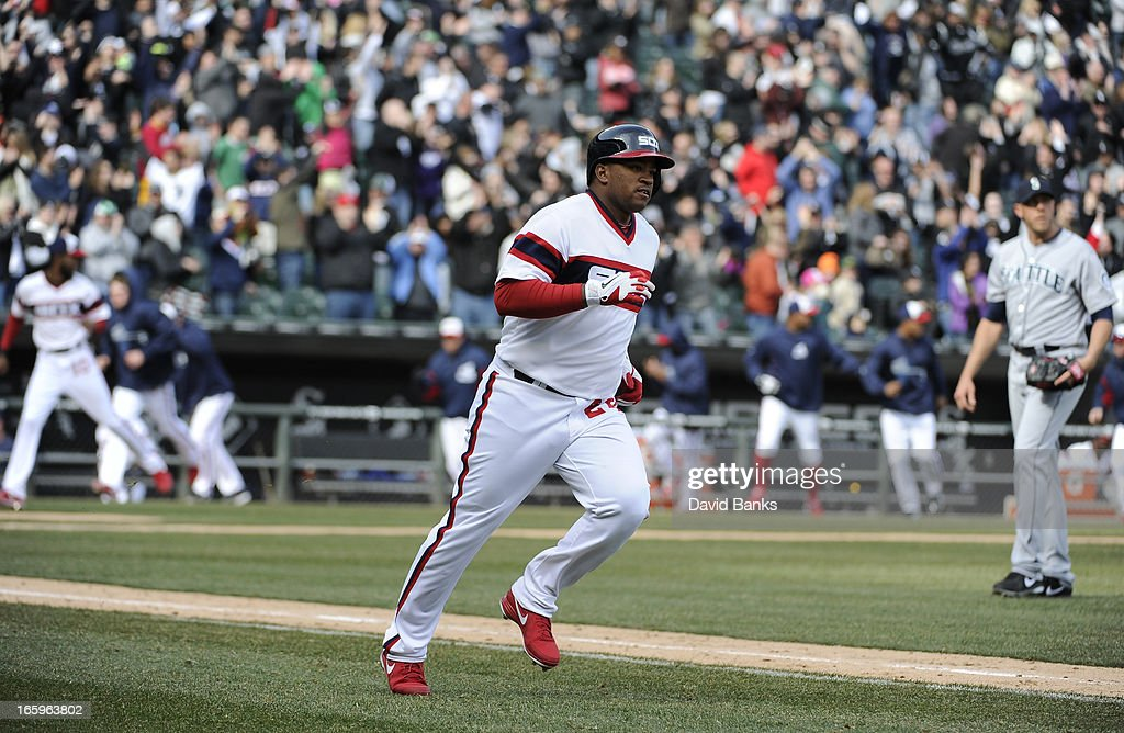 Dayan Viciedo #24 of the Chicago White Sox runs the bases after hitting a walk-off homer in the tenth inning against the Seattle Mariners on April 7, 2013 at U.S. Cellular Field in Chicago, Illinois. The Chicago White Sox defeated the Seattle Mariners 4-3.
