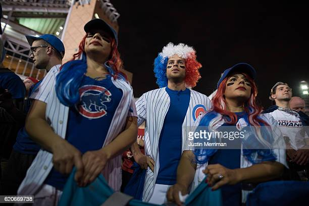 Dayana Guzman Alex Marquez and Doraliz GuzmanMarquez all of Chicago cheer for the Cubs outside of Progressive Field during game 7 of the World Series...