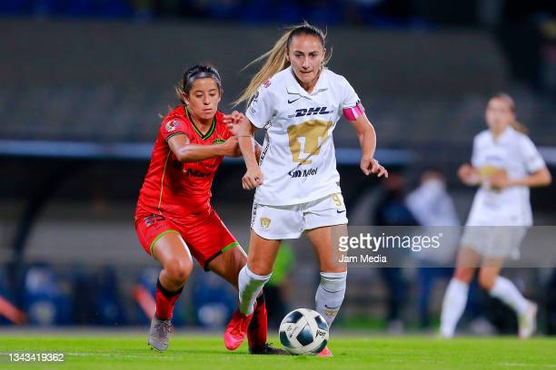 Dayana Navarrete of Juarez fights for the ball with Dinora Lizeth Garza of Pumas during a match between Pumas and Juarez as part of the Torneo Grita...