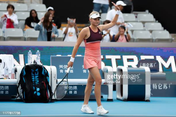 Dayana Yastremska of Ukraine celebrates after winning the women's singles first round match of 2019 China Open Caroline Garcia of France at the China...