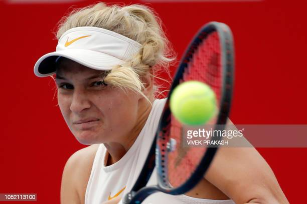 Dayana Yastremska of Ukraine hits a return during her women's singles final match against Wang Qiang of China at the Hong Kong Open tennis tournament...