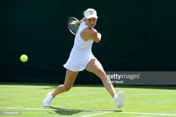 Dayana Yastremska of Ukraine plays a backhand in her Ladies' Singles first round match against Camila Giorgi of Italy during Day one of The...
