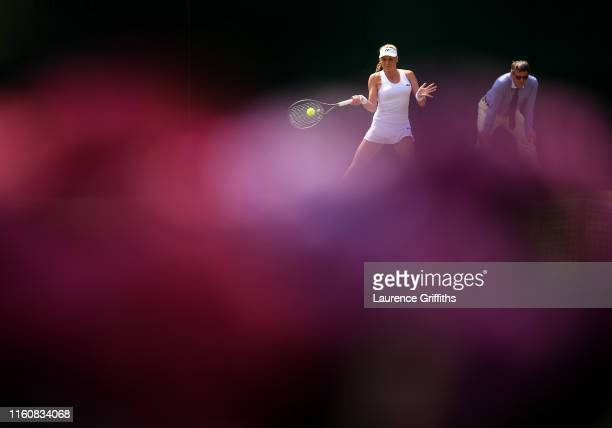Dayana Yastremska of Ukraine plays a forehand in her Ladies' Singles fourth round match against Shuai Zhang of China during Day Seven of The...