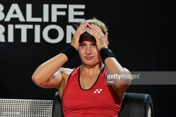 Dayana Yastremska of Ukraine reacts as she sits down during a change of ends in her round one match against Camila Giorgi of Italy during day one of...
