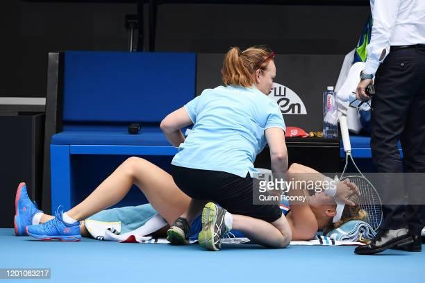Dayana Yastremska of Ukraine receives medical treatment during her Women's Singles second round match against Caroline Wozniacki of Denmark on day...