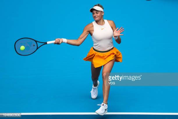 Dayana Yastremska of Ukraine returns a shot in the Women's Singles first round match against Zheng Saisai of China attends a press conference on day...