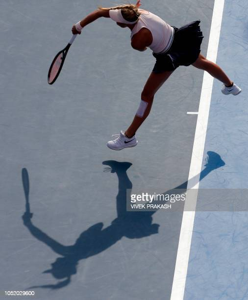Dayana Yastremska of Ukraine serves to Zhang Shuai of China during their women's singles semifinal match at the Hong Kong Open tennis tournament on...