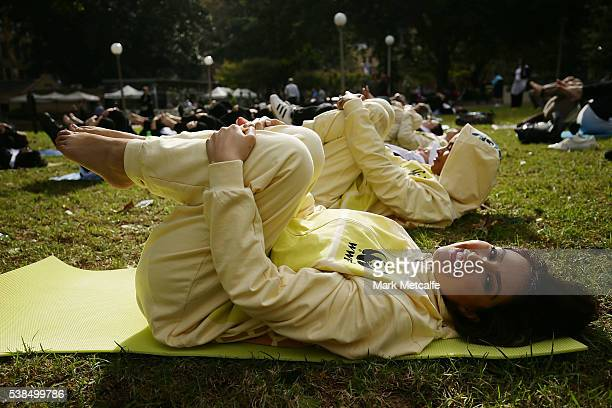 Dayanna Grageda Miss Earth Australia wears an animal onesie whilst particpating in a Yoga class at Hyde Park on June 7 2016 in Sydney Australia The...