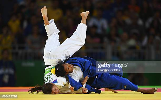 Dayaris Mestre Alvarez of Cuba competes against Sarah Menezes of Brazil in the Women's 48 kg Judo on Day 1 of the Rio 2016 Olympic Games at Carioca...