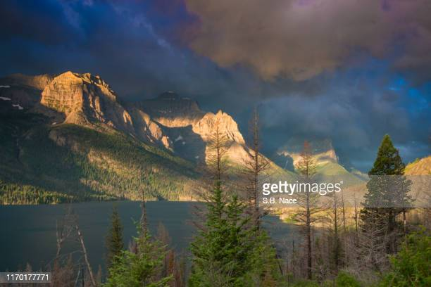 daybreak in mountains: st. mary's lake - mary lake stock photos and pictures