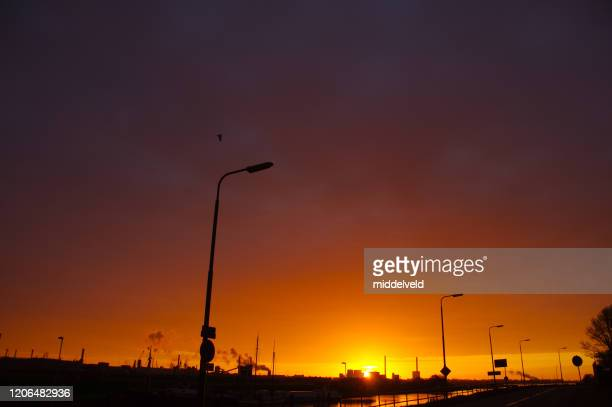 daybreak over blast furnace ijmuiden - generator stock pictures, royalty-free photos & images