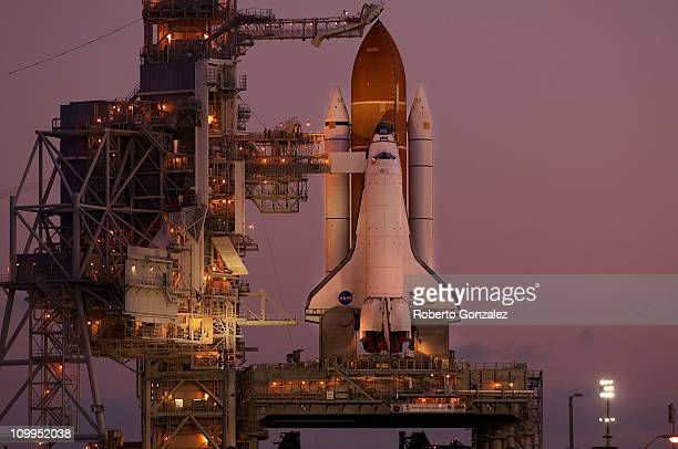 Daybreak reveals the space shuttle Endeavour shortly after arriving at Launch Pad 39A on March 11 2011 in Cape Canaveral Florida Endeavour's liftoff...