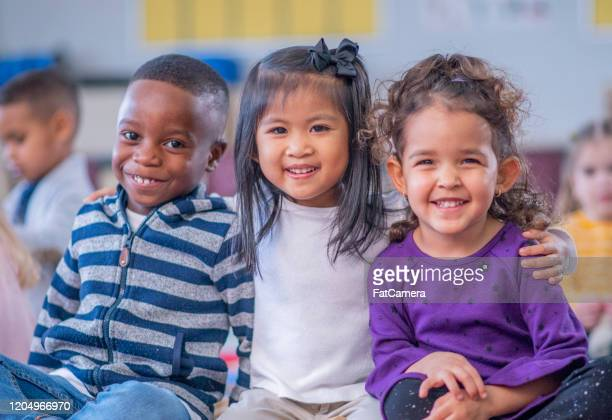 daycare children portrait stock photo - nursery school child stock pictures, royalty-free photos & images