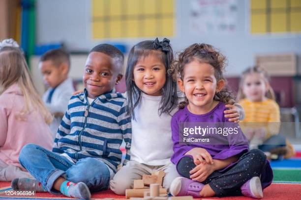 daycare children portrait stock photo - preschool child stock pictures, royalty-free photos & images