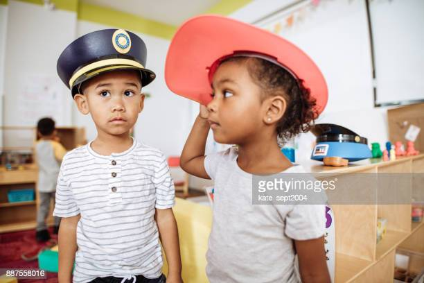 Daycare kids in professionals hats