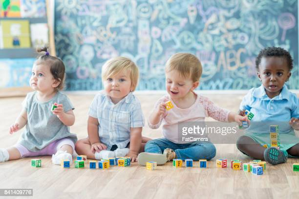 daycare kids - preschool building stock pictures, royalty-free photos & images