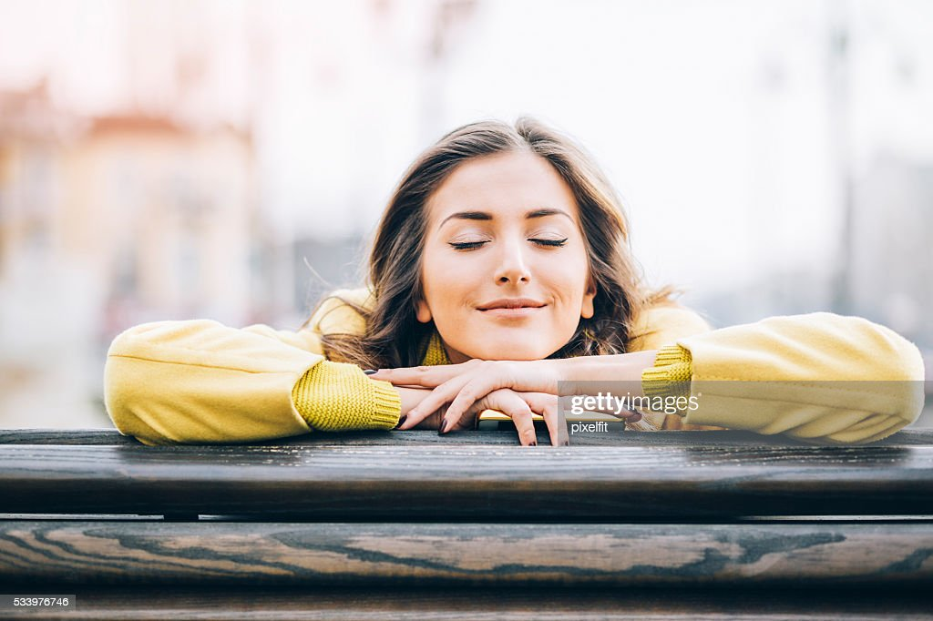 Daydreaming and enjoying the sunlight : Stock Photo