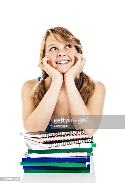 daydreaming female teenager with books - girl mound stock pictures, royalty-free photos & images