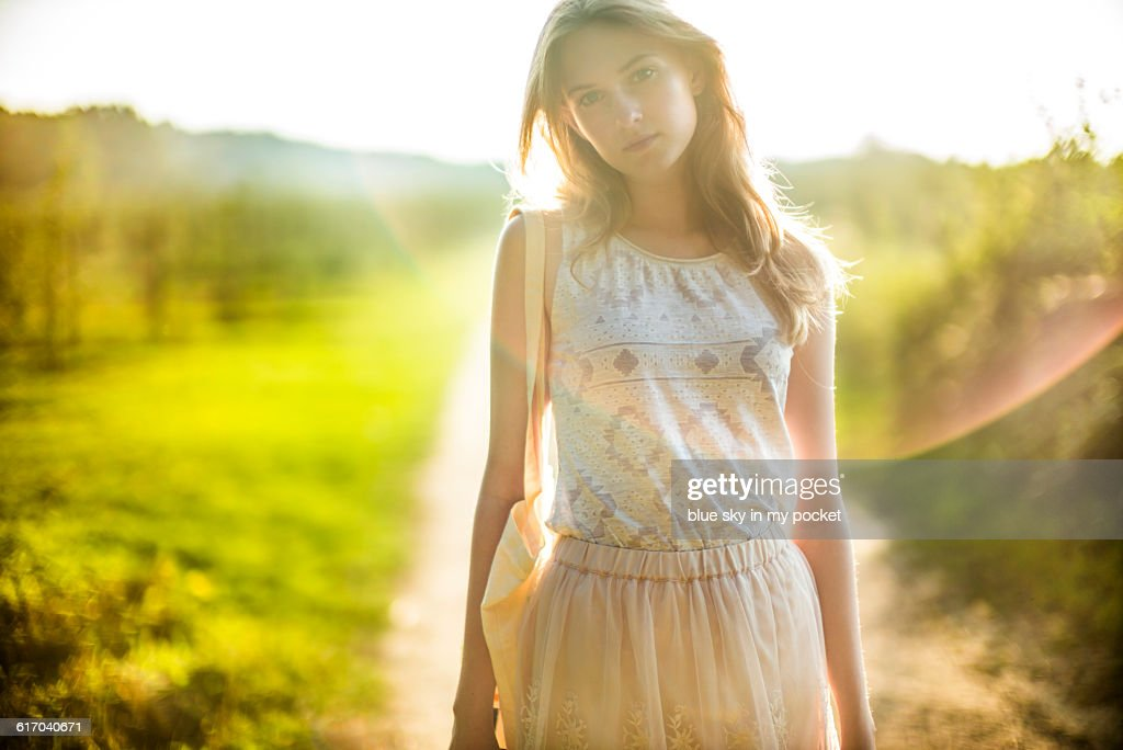 Daydreaming girl in the countryside. : Stock Photo