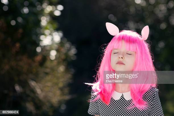 Daydreaming girl with pink hair and rabbit ears