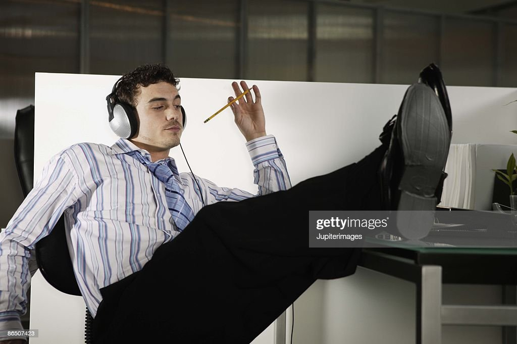Daydreaming office worker : Stock Photo