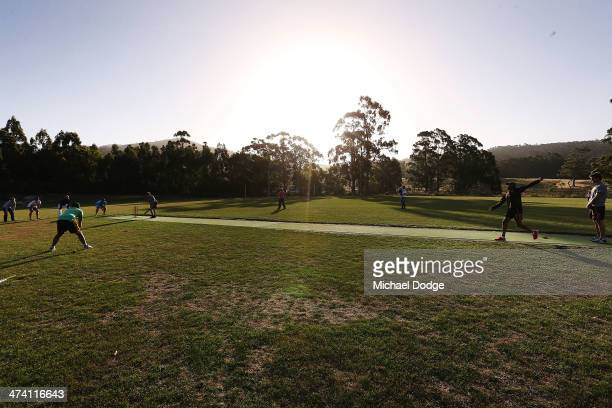 Dayle Garlett bowls to Taylor Duryea in a game of cricket with members of the Port Arthur Cricket Club during the Hawthorn Hawks AFL Community Camp...