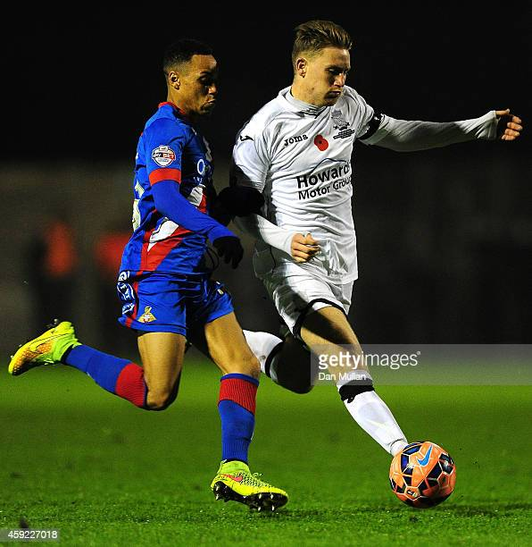 Dayle Grubb of WestonSuperMare battles for the ball with Kyle Bennett of Doncaster Rovers during the FA Cup First Round match between WestonSuperMare...
