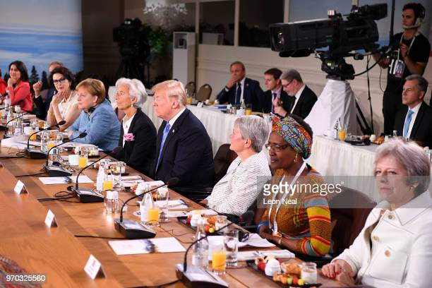 Dayle Haddon Christine Lagarde US President Donald Trump Christine Whitecross Winnie Byanyima and British Prime Minister Theresa May shortly after...