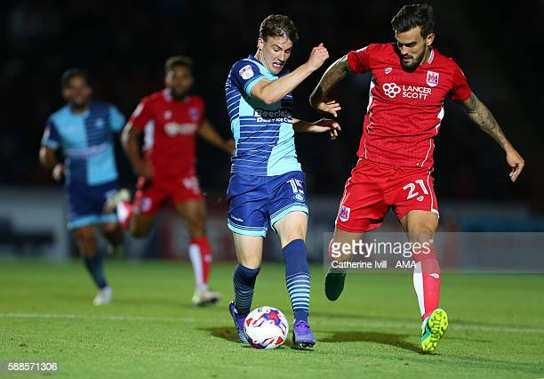 Dayle Southwell of Wycombe Wanderers and Marlon Pack of Bristol City during the EFL Cup match between Wycombe Wanderers and Bristol City at Adams...