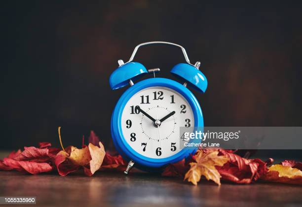 daylight savings time. clocks fall back - daylight saving time stock pictures, royalty-free photos & images