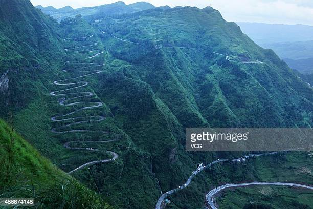 A daylight view of a mountain pass before nearly 3000 people carry torches along a zigzag mountain path of 24 bends to celebrate the 70th anniversary...
