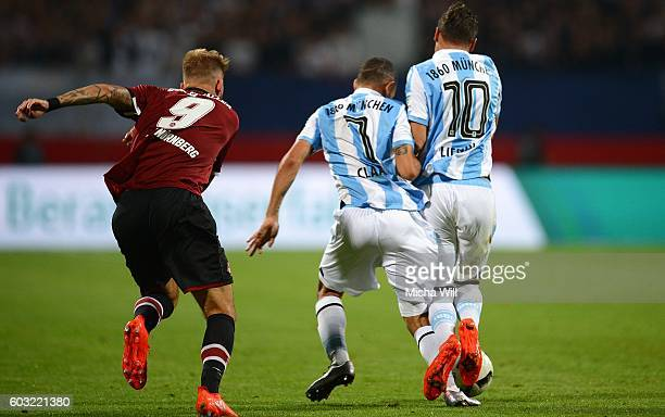 Daylon Claasen and Michael Liendl of Muenchen clash during the Second Bundesliga match between 1 FC Nuernberg and TSV 1860 Muenchen at Arena...