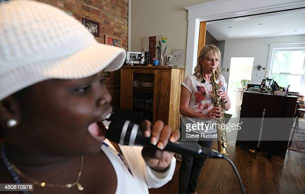 TORONTO ON JUNE 14 Dayme Arocena sings vocals as Saxophone player Jane Bunnett and her allgirl Cuban band rehearse for their upcoming tour and...