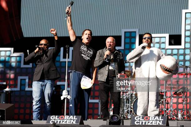 Daymond John Mark Cuban Kevin O'Leary and Kal Penn speak during the 2017 Global Citizen Festival at The Great Lawn of Central Park on September 23...