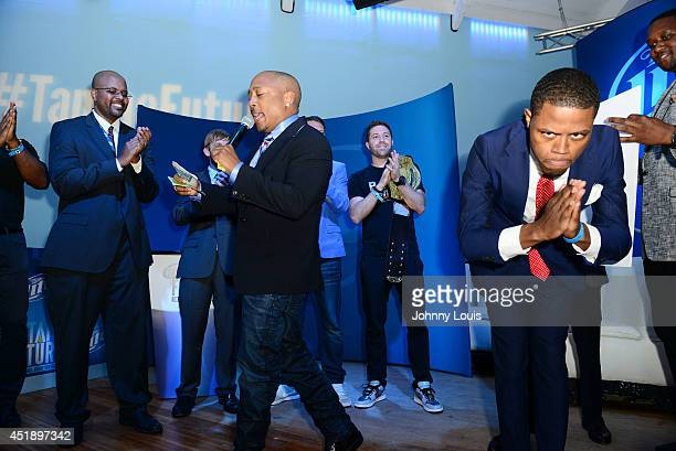 Daymond John on satge with contestant and winner of Tap The Future event Derrius Quarles at Nikki Beach on July 8 2014 in Miami Beach Florida