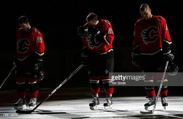 April 17: Daymond Langkow, Kristian Huselius and Jarome Iginla of the Calgary Flames stand during the national anthems prior to their match against...