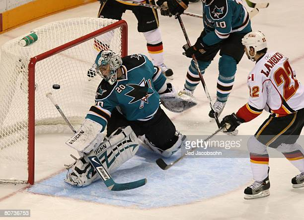 Daymond Langkow of the Calgary Flames scores a goal in the third period against Evgeni Nabokov of the San Jose Sharks during game five of the 2008...