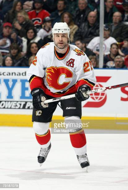 Daymond Langkow of the Calgary Flames skates for the puck during the game against the Edmonton Oilers at Rexall Place on January 20 2007 in Edmonton...