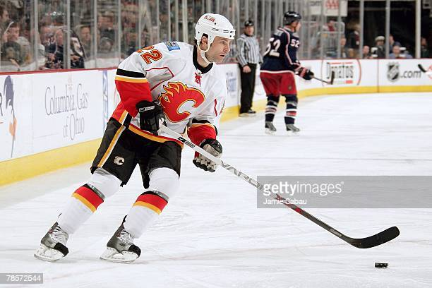 Daymond Langkow of the Calgary Flames skates with the puck against the Columbus Blue Jackets on December 18 2007 at Nationwide Arena in Columbus Ohio